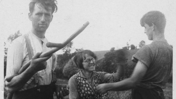 Patrick Kavanagh with his siblings Josie and Peter saving the hay in 1934
