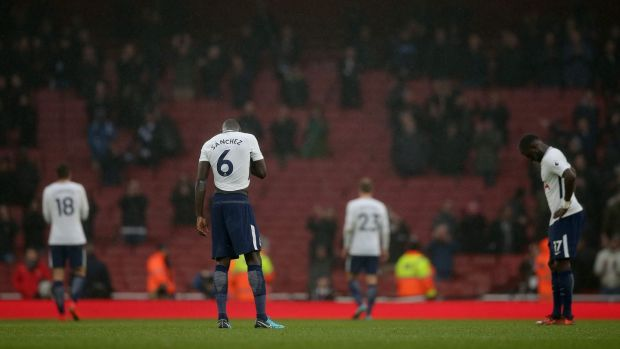 Spurs players react after their 2-0 Premier League loss to Arsenal at the Emirates. Photo: Daniel Leal-Olivas/Getty Images