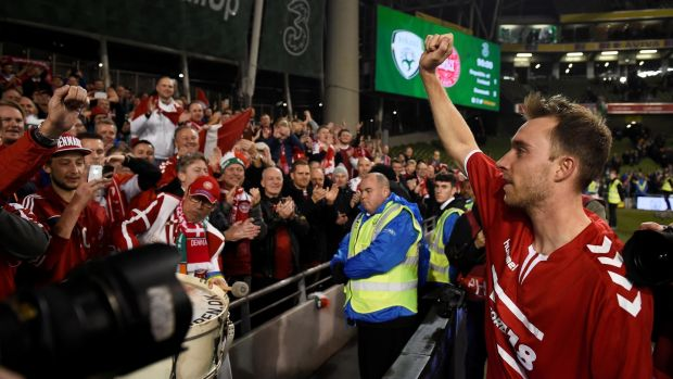 Denmark's Christian Eriksen celebrates with fans after they beat Ireland at the Aviva stadium to qualify for the World Cup. Photo: Clodagh Kilcoyne/Reuters