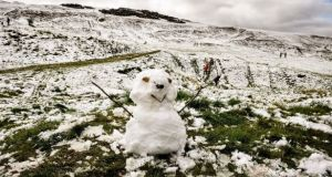 It's going to get cold on Wednesday, but you might have to find a mountain top if you want to build a snowman. File image: PA