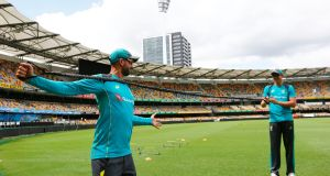 Australia's Nathan Lyon warms up during a nets session at The Gabba, Brisbane. Photograph: PA