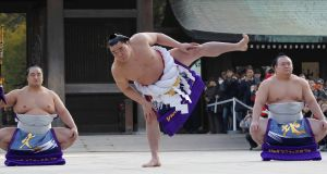 Yokozuna Harumafuji during the New Year's ring-entering rite at the annual celebration for the New Year at Meiji Shrine. Photograph: Yuya Shino/Reuters