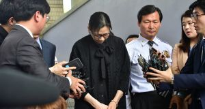 Former Korean Air executive Cho Hyun-Ah surrounded by journalists after she was freed by a Seoul appeals court in May2015, following her jailing for disrupting a flight in a rage over macadamia nuts. Photograph:  Jung Yeon-Je/AFP/Getty Images