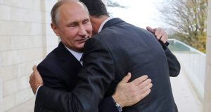 Russian president Vladimir Putin and Syrian president Bashar al-Assad hug at a meeting in the Black Sea resort of Sochi, Russia on Monday. Photograph: Mikhail Klimentyev, Kremlin Pool Photo via AP