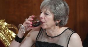 UK prime minister Theresa May drinks a glass of wine as she listens to speeches at the annual Lord Mayor's Banquet at the Guildhall in London. Photograph: Victoria Jones/PA Wire