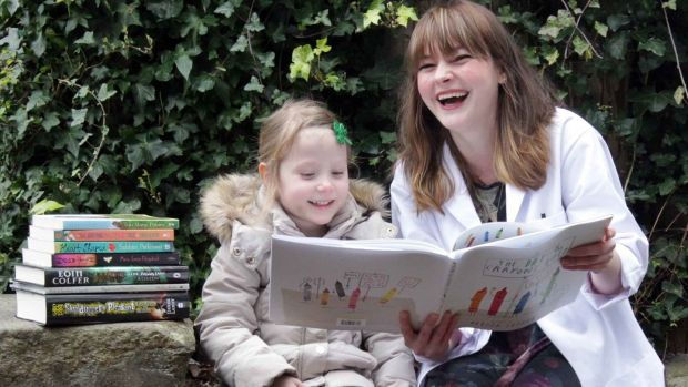 The book doctor will see you now:Three-year-old Nahla Burke and Children's Books Ireland Book Doctor Kim Harte.