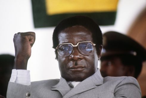 "This file photo taken on July 01, 1984 shows Zimbabwe's Prime Minister Robert Mugabe clenching his fistin Harare stadium during a meeting.   Robert Mugabe resigned as president of Zimbabwe on November 21, 2017, parliament speaker Jacob Mudenda told lawmakers, ending a 37-year rule defined by brutality and economic collapse. ""I Robert Gabriel Mugabe in terms of section 96 of the constitution of Zimbabwe hereby formally tender my resignation... with immediate effect,"" said speaker Mudenda, reading the letter. / AFP PHOTO / ALEXANDER JOEALEXANDER JOE/AFP/Getty Images"