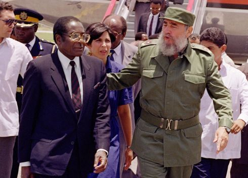 "This file photo taken on June 8, 1992 shows Zimbabwe's President Robert Mugabe (L) greeted in Havana by Cuban President Fidel Castro. Robert Mugabe resigned as president of Zimbabwe on November 21, 2017, parliament speaker Jacob Mudenda told lawmakers, ending a 37-year rule defined by brutality and economic collapse. ""I Robert Gabriel Mugabe in terms of section 96 of the constitution of Zimbabwe hereby formally tender my resignation... with immediate effect,"" said speaker Mudenda, reading the letter. / AFP PHOTO / RAFAEL PEREZRAFAEL PEREZ/AFP/Getty Images"