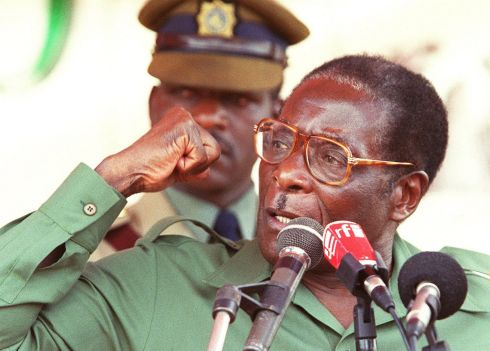 "This file photo taken on April 08, 2000 shows Zimbabwe President Robert Mugabe speaks at his first election rally for the coming Parliamentary elections in Bindura, 80 kilometers north of Harare.   Robert Mugabe resigned as president of Zimbabwe on November 21, 2017, parliament speaker Jacob Mudenda told lawmakers, ending a 37-year rule defined by brutality and economic collapse. ""I Robert Gabriel Mugabe in terms of section 96 of the constitution of Zimbabwe hereby formally tender my resignation... with immediate effect,"" said speaker Mudenda, reading the letter. / AFP PHOTO / paul cadenheadPAUL CADENHEAD/AFP/Getty Images"