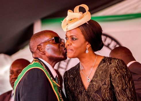 "This file photo taken on April 18, 2017 shows President Robert Mugabe kissing his wife and first lady Grace Mugabe during the country's 37th Independence Day celebrations at the National Sports Stadium in Harare. Robert Mugabe resigned as president of Zimbabwe on November 21, 2017, parliament speaker Jacob Mudenda told lawmakers, ending a 37-year rule defined by brutality and economic collapse. ""I Robert Gabriel Mugabe in terms of section 96 of the constitution of Zimbabwe hereby formally tender my resignation... with immediate effect,"" said speaker Mudenda, reading the letter. / AFP PHOTO / Jekesai NJIKIZANAJEKESAI NJIKIZANA/AFP/Getty Images"