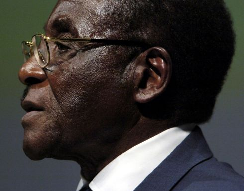 Zimbabwean President Robert Mugabe addressing the inaugural session of the World Summit in Geneva, Switzerland December 10, 2003. REUTERS/Denis Balibouse/File Photo       TPX IMAGES OF THE DAY