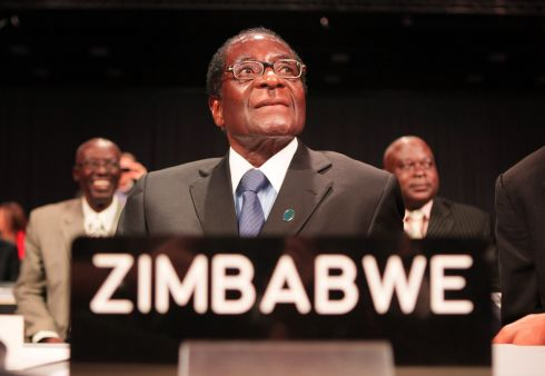 Robert Mugabe Resigns As President of Zimbabwe COPENHAGEN, DENMARK - DECEMBER 15:  President Robert Mugabe of Zimbabwe looks up as he attends the opening ceremony of the High Level Segment of The United Nations Climate Change Conference on December 15, 2009 in Copenhagen, Denmark. Politicians and environmentalists are meeting for the United Nations Climate Change Conference 2009 that runs until December 18. Some of the participating nation's leaders will attend the last days of the summit.  (Photo by Peter Macdiarmid/Getty Images)