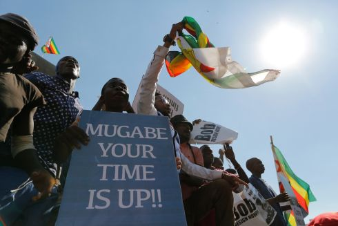 People protest outside parliament as lawmakers are to attend a parliament session in Harare, Zimbabwe, 21 November 2017. Zimbabwe's lower house opened a hearing to discuss an impeachment motion of censure against President Robert Mugabe, who has lost his own party's support since the military takeover.  EPA/KIM LUDBROOK