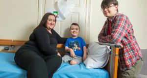 Gillian Duffy and her sons Joshua and William (17) at home in Ballindangan, Mitchelstown, Co Cork. Gillian's son Joshua goes to school with the help of a special needs assistant.  Photograph:  Michael Mac Sweeney/Provision