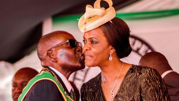Mugabe resigns: the Zimbabwean president with his wife, Grace, during the country's 37th Independence Day celebrations, in April. Photograph: Jekesai Njikizana/AFP/Getty
