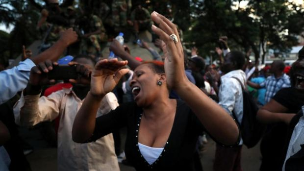 Mugabe resigns: Zimbabweans celebrate in Harare. Photograph: Mike Hutchings/Reuters