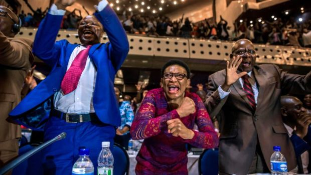 Mugabe resigns: Zimbabwean politicians celebrate in parliament in Harare. Photograph: Jekesai Njikizana/AFP/Getty