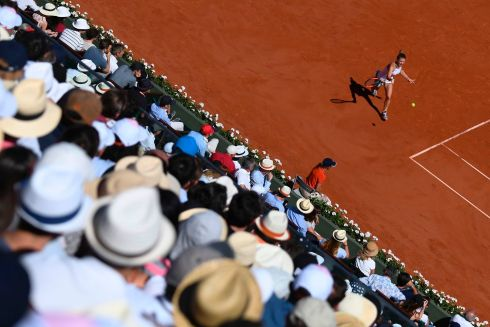 The crowd watches Romania's Simona Halep return the ball to Latvia's Jelena Ostapenko during their French Open final at Roland Garros.  Photo: Getty Images