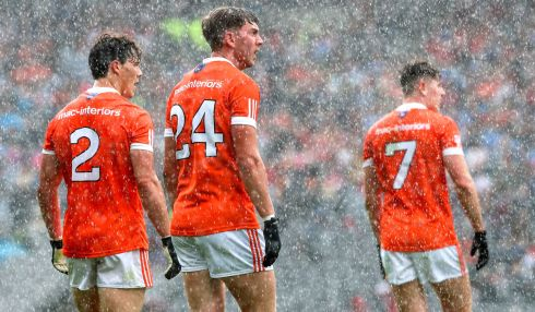 Armagh's James Morgan, Anthony Duffy and Joe McElroy look on as Tyrone score a late point in their quarter-final. Photo: James Crombie/Inpho