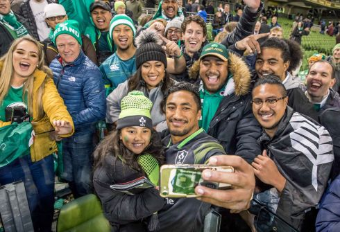 Ireland's Bundee Aki takes a picture with his daughter Adrianna Aki and family members after his debut against South Africa. Photograph: Morgan Treacy/Inpho