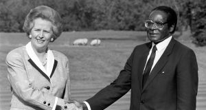 British prime minister Margaret Thatcher with Robert Mugabe in October, 1988. Photograph: PA Wire
