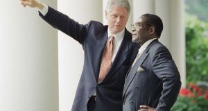 US president Bill Clinton with Robert Mugabe at the White House in May, 1995. Photograph: Greg Gibson/AP