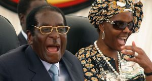 Robert Mugabe and his wife Grace, in March 2008. Photograph: AP