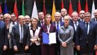 European Union foreign policy chief Federica Mogherini, centre, with EU foreign and defence ministers after signing the notification on Pesco
