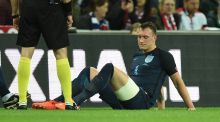 Phil Jones goes down injured during England's friendly match with Germany at Wembley. Photo: EPA