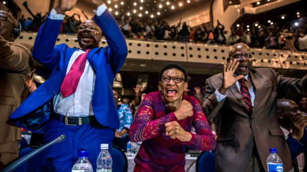 Zimbabwe's members of parliament celebrate after Robert Mugabe's resignation. Photograph: AFP/Getty Images