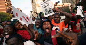 DICTATOR OUSTED: Zimbabweans celebrate upon the resignation of President Robert Mugabe in Harare, Zimbabwe, after 37 years of autocratic rule. Photograph: Mike Hutchings/Reuters