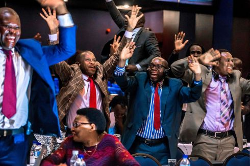 JOY IN PARLIAMENT: Members of parliament celebrate after President Robert Mugabe's resignation in Harare, Zimbabwe. The news was delivered by the parliament speaker to a session of the assembly which had convened to impeach Mugabe (93).  Photograph: Jekesai Njikizana/AFP/Getty Images