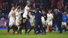 Guido Pizarro of Sevilla celebrates with team mates and staff members after scoring his side's third goal in their Champions League clash with Liverpool. Photo: David Ramos/Getty Images