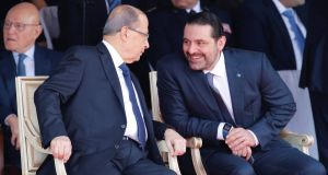 Saad Hariri (right), who announced his resignation as Lebanon's prime minister from Saudi Arabia,  talks with Lebanese president Michel Aoun at a military parade to celebrate the 74th anniversary of Lebanon's independence in  Beirut on Wednesday. Photograph: Mohamed Azakir/Reuters