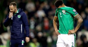 The Republic of Ireland's Cyrus Christie shows his dejection following the World Cup defeat to Denmark. Photograph: Ryan Byrne/Inpho