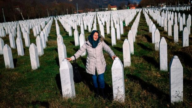A woman mourns over a relative's grave at the memorial centre of Potocari near Srebrenica in Bosnia and Herzegovina. Photograph: Dimitar Dilkoff/AFP/Getty Images