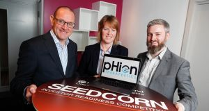 Phion Therapeutics founder Helen McCarthy is flanked by Seedcorn project manager Connor Sweeney and Qubis spin-out manager Darach Neeson. Photograph: Conor McCabe