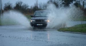DRIVING RAIN: Heavy rain causes flooding in Co Meath near the M3 at Dunboyne. Photograph: Alan Betson/The Irish Times