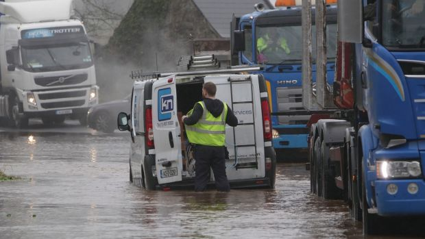 A van driver is stuck in floodwaters on the R352 near Bodyke in Co Clare. Photograph: Press 22
