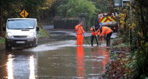 Vehicles drive through floods as workers attempt to clear drains after heavy flooding on the Strawberry Beds, Lower Road near Lucan.Photograph: Colin Keegan, Collins Dublin.