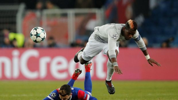 Basel's Renato Steffen in action with Manchester United's Paul Pogba during their Champions League clash. Photo: Arnd Wiegmann/Reuters