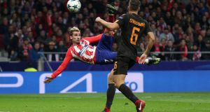 Atletico Madrid's Antoine Griezmann scores their first goal in a 2-0 win over Roma. Photo: Sergio Perez/Reuters