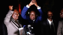 Mnangagwa promises 'a new democracy' as he returns to Zimbabwe