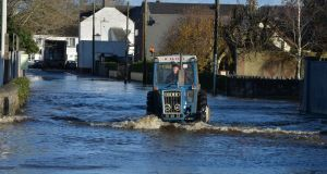 Flooding from the River Owenass on the Manor Road in Mountmellick, Co Laois. Photograph: Alan Betson / The Irish Times