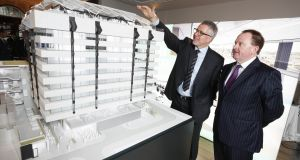 Brian Moran, senior managing director of Hines Ireland, with Declan O'Reilly, director of office agency at Knight Frank with a scale model of the former Central Bank building.