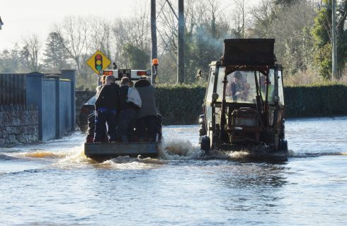 KEEP ON TRUCKING: Local residents on the Manor Road in Mountmellick. Photograph: Alan Betson/The Irish Times
