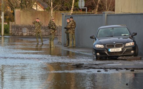 Members of the Defence forces on the Manor Road in Mountmellick where up to half a meter of water entered  homes in the area. Photograph: Alan Betson / The Irish Times