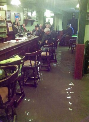 People sit in Dowlings pub in Mountmellick, County Laois, with flood water around their feet.  Photograph: Paddy Nicholson/Handout/PA Wire  NOTE TO EDITORS: This handout photo may only be used in for editorial reporting purposes for the contemporaneous illustration of events, things or the people in the image or facts mentioned in the caption. Reuse of the picture may require further permission from the copyright holder.