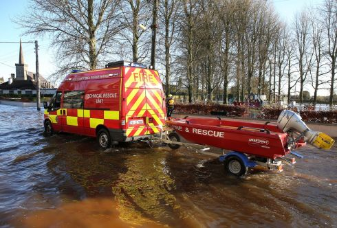 A technical rescue unit of the fire service drives through flood water in Mountmellick. Photograph: Brian Lawless/PA Wire