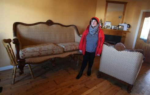 Bernadette Dunne stands in her flood damaged sitting room in Mountmellick. Photograph: Brian Lawless/PA Wire